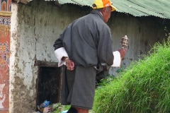 MAN WITH PRAYER WHEEL